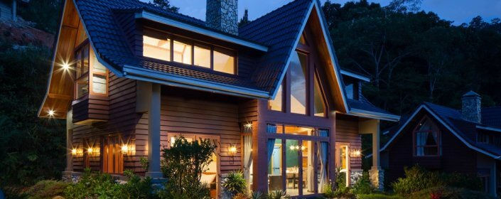 Modern home lit up at night with beautiful, welcoming front entry