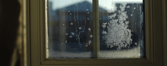 window with condensation and frost on it